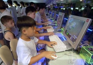 Dozens of South Korean cyber gamers confront each other in Taejeon's PC Bang Room. -- PHOTO: AFP, 12/2/2010